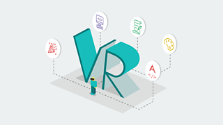 A small figure of a man looking at two giant letters which spell out VR.