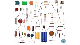A collection of electronic components of varying size and colour, on a white backdrop.