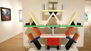 A colourful abstract bookcase displayed in an art gallery.