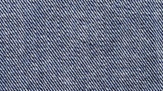 A close-up of a twill weave within denim jeans.