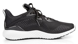 A single, new and unbranded black sport running shoe.