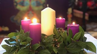 Photograph of advent wreath with four lit candles