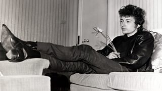 Bob Dylan sat backstage with a flower in hand.