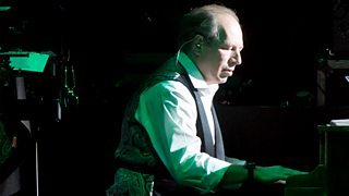 Hans Zimmer playing an electric piano during a live performance.