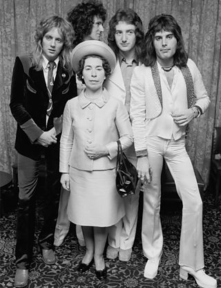 The band Queen with a Her Royal Highness Queen Elizabeth II look-a-like.
