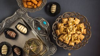 Chocolate, pastries and sweets in dishes on a table
