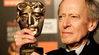 A close-up shot of John Barry with his BAFTA.
