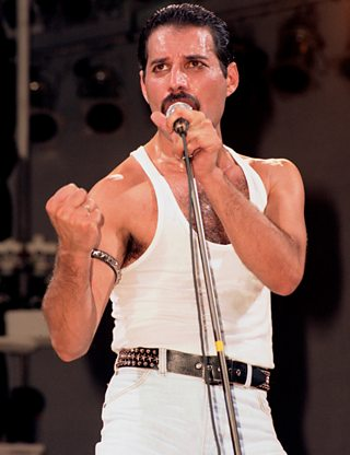 Freddie Mercury performing with Queen at Wembley Stadium for Live Aid.