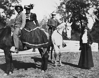 Personal photo of white landowners standing with African-American sharecroppers in the American South, circa 1910