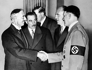 A photograph of Adolf Hitler greeting British Prime Minister Neville Chamberlain at Munich 1938