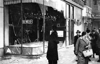 Photograph of smashed windows of a Jewish shop in Berlin in the aftermath of Kristallnacht