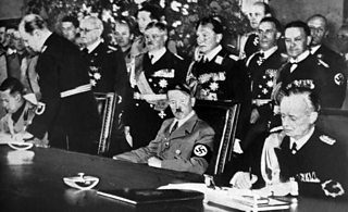 Photograph of Galeazzo Ciano, Adolf Hitler and Joachim Von Ribbentrop at the signing of the Pact of Steel in the Reichskanzlei in Berlin 22 May 1939