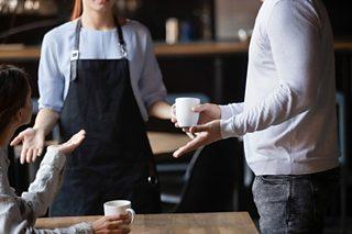 A waitress handling a customer complaint.