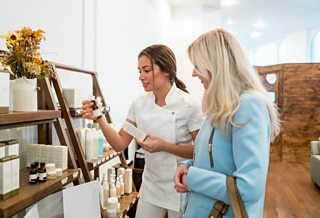 A spa guest browsing beauty products.