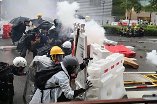 Protesters in Hong Kong defend themselves against tear gas. 25th Aug, 2019
