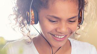 Girl with headphones on.