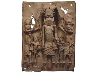 A brass plaque shows an Oba with his attendants.