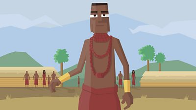 A Benin chief wearing coral necklaces and bracelets