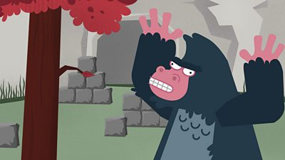An angry gorilla looking at blocks outside his house.