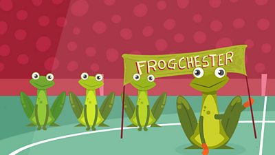"Frogs holding up a ""Frogchester"" banner in a football stadium."