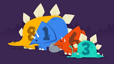 A group of colourful dinosaurs standing in a line.