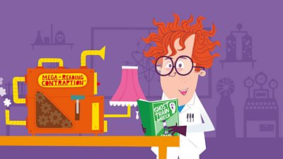 Frank holding his book in his laboratory