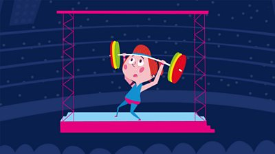 Jess lifting weights competitively under a spotlight in a dark arena with lots of people