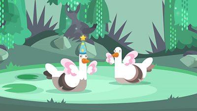 two ducks dressed like fairies on a lake
