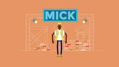 Mick the builder standing under a sign of his name in lights