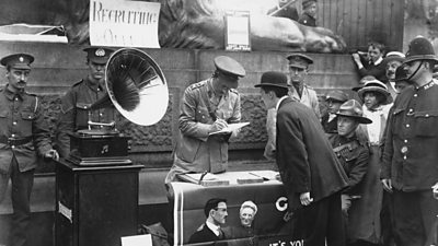 Photo of man giving his name at a recruitment drive in Trafalgar Square in World War One
