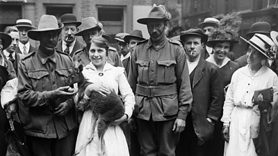 Australian and New Zealand Army Corps with their one year old pet kangaroo in 1916
