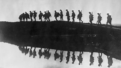 World War One soldier marching reflected in a lake