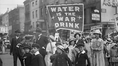 A march for prohibition with men, women and children during World War One