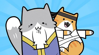 two cats doing karate