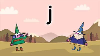 Two wizards on a colourful background looking at the letter J