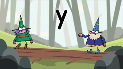 Two wizards on a colourful background looking at the letter y