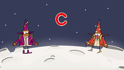 On the moon, two happy wizards, one purple, one red, stand next to the letter 'c'