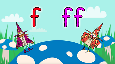 On a blue toadstool two happy wizards, one purple, one red, stand by letters 'f' and 'ff'