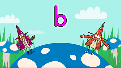 On a blue toadstool, two happy wizards, one purple, one red, stand next to the letter 'b'