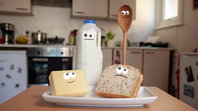 Milk, wooden spoon, bread and cheese for the Bitesize Food film
