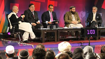 A panel of five politicians on the stage, including then-president Hamid Karzai.