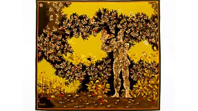 A yellow coloured tapestry with a figure of a man amongst stylised leaves.