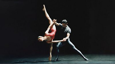 A male and female ballet dancer - the woman is balanced on one leg and is almost upside-down.