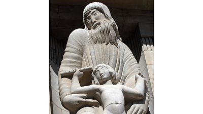 Eric Gill's statue of Prospero - a bearded man with long wavy hair, head turned to one side.