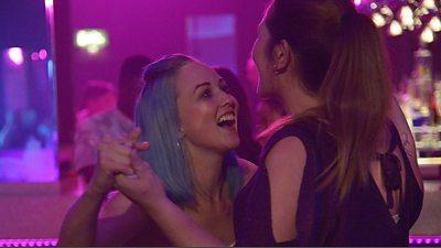 Lynn (Roxanne Scrimshaw) and Lucy (Nichola Burley) dance in a nightclub