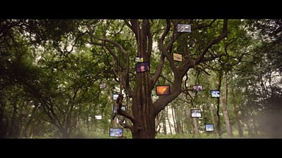 A tree with flatscreen televisions hanging from it