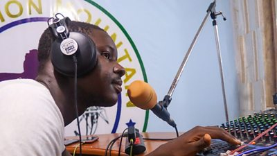 An announcer on air at Lion Mountain Radio