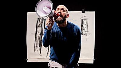 Jonny Cotsen holding a microphone
