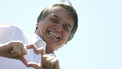 Bolsonaro making a heart sign with his fingers