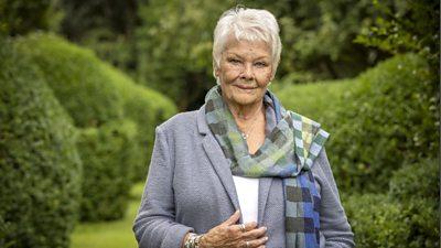 Judi Dench in a garden